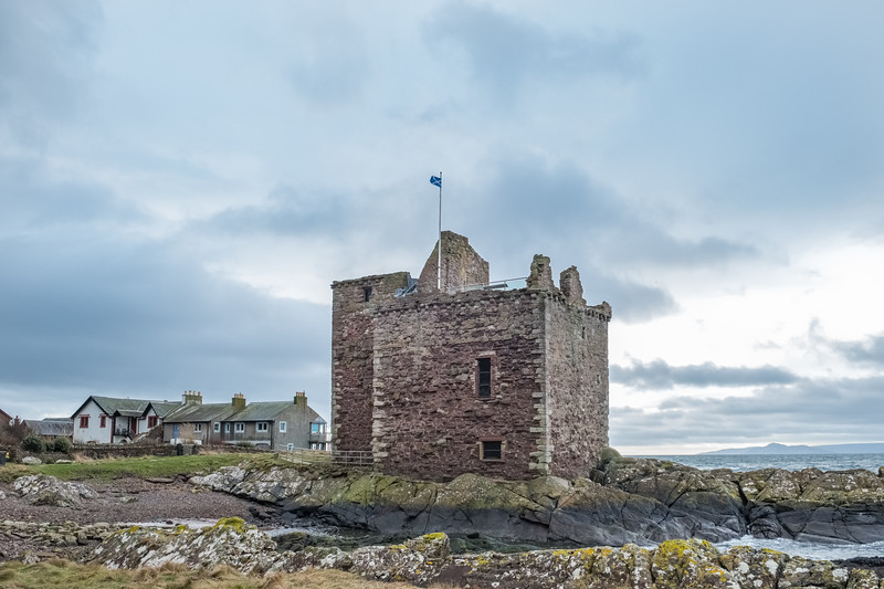 Saltire Flag of Scotland Flying Proudly from the Old Castle Ruins that are Portencross in Seamill Scotland