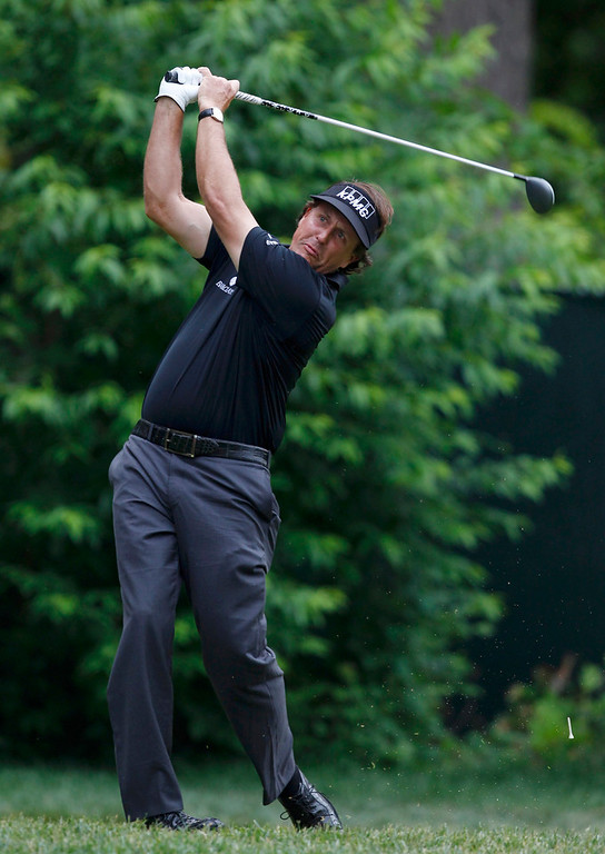 . Phil Mickelson of the U.S. tees off on the 12th hole during the first round of the 2013 U.S. Open golf championship at the Merion Golf Club in Ardmore, Pennsylvania, June 13, 2013. REUTERS/Matt Sullivan