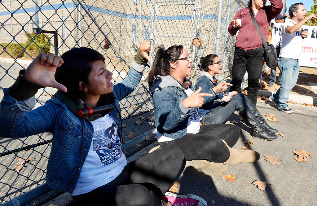 . Over 100 protesters took part in a peaceful rally Monday November 25, 2013 at the privately owned Adelanto Detention Facility in Adelanto, Calif. The protesters, with the Inland Empire Immigrant Coalition, were protesting  to demand the release of three prisoners on ICE holds who they say shouldn\'t be incarcerated because they\'re infractions were minor and they\'ve been in too long already. It comes in the wake of highly critical report recently released by the nonprofit Detention Watch Network, detailing alleged abuses and civil rights violations of prisoners at the Adelanto facility and nine similar institutions nationwide.(Will Lester/Inland Valley Daily Bulletin)