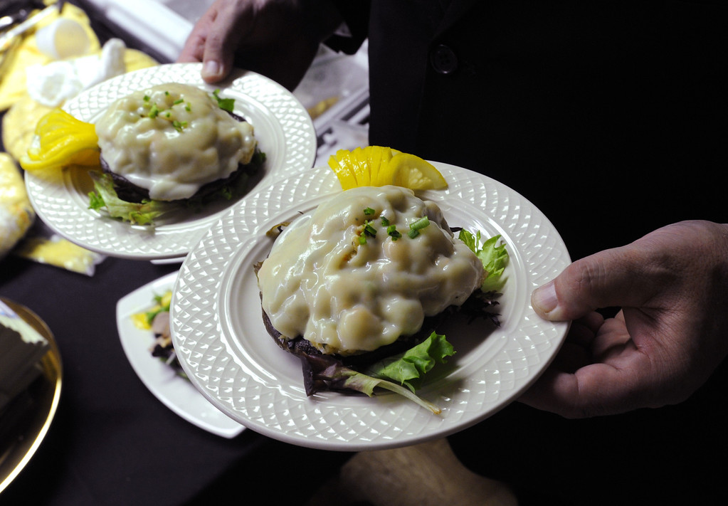 . Red king crab stuffed portobello mushrooms are served to four-time Iditarod champion Martin Buser after he arrived first at the Yukon River in Anvik, Alaska, during the Iditarod Trail Sled Dog Race, early Friday, March 8, 2013. (AP Photo/Anchorage Daily News, Bill Roth)