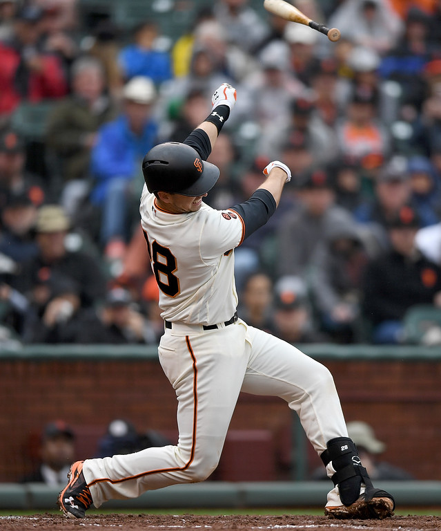 . SAN FRANCISCO, CA - MAY 07:  Buster Posey #28 of the San Francisco Giants swings and loses control of his bat against the Colorado Rockies in the bottom of the fourth inning at AT&T Park on May 7, 2016 in San Francisco, California.  (Photo by Thearon W. Henderson/Getty Images)