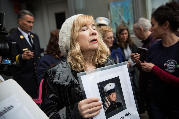 . Sally Regenhard, mother of fire fighter Christian Regenhard, a victim of the September 11, 2001 attack, and other victim\'s family members protest the decision by city officials to keep unidentified human remains of the 9-11 victims at the 9-11 Museum at the World Trade Center site, on May 10, 2014 in New York City. The decision by city officials to keep the remains at the museum until they are able to be identified has drawn both support and criticism by families of victims. The remains were moved early this morning from the medical examiner\'s repository to the 9-11 Museum.  (Photo by Andrew Burton/Getty Images)
