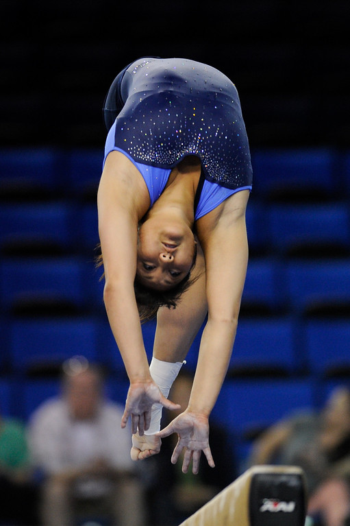 . UCLA\'s Sydney Sawa practices on the beam. (Michael Owen Baker/Staff Photographer)