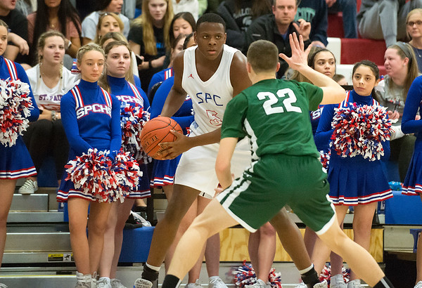 03/09/20 Wesley Bunnell | StaffrrSt. Paul boys basketball vs Maloney at St. Paul Catholic High School on Monday March 9, 2020. A.J. Brooks (5)