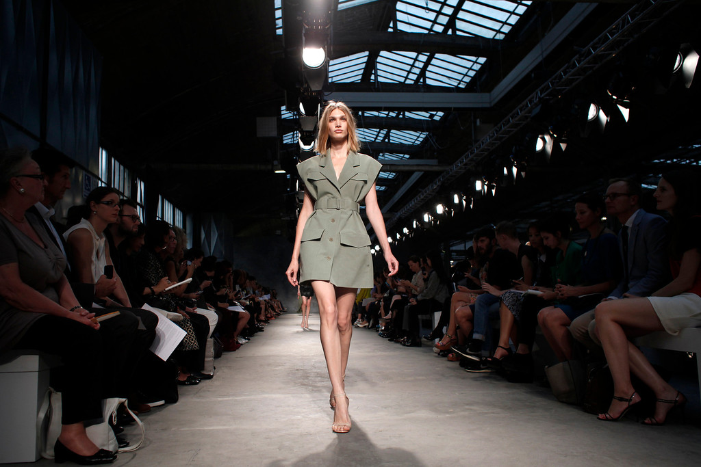 . A model presents a creation as part of Portuguese fashion designer Felipe Oliveira Baptista\'s ready-to-wear Spring/Summer 2014 fashion collection presented in Paris, Wednesday, Sept. 25, 2013. (AP Photo/Thibault Camus)