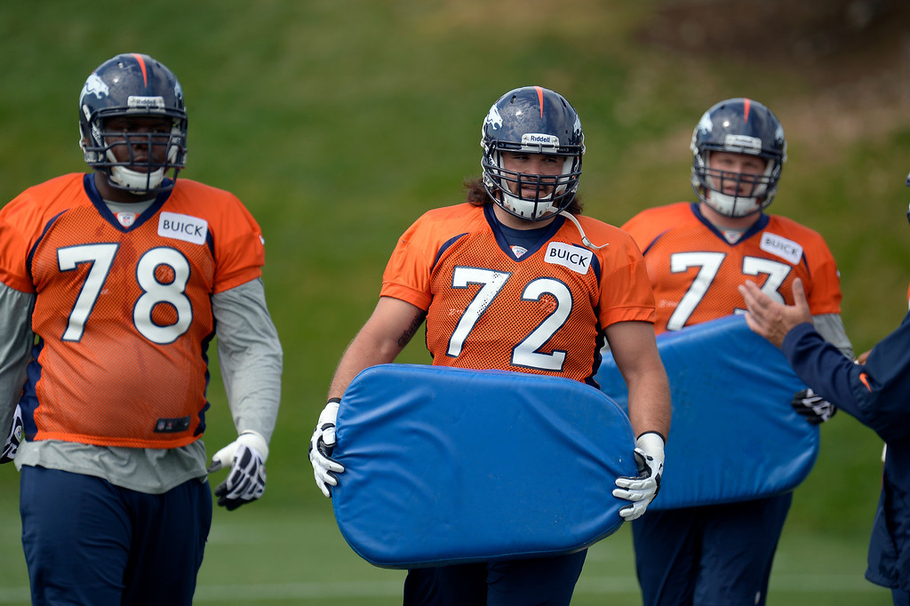 . Denver Broncos G John Moffitt works with the offense during practice August 23, 2013 at Dove Valley (Photo by John Leyba/The Denver Post)