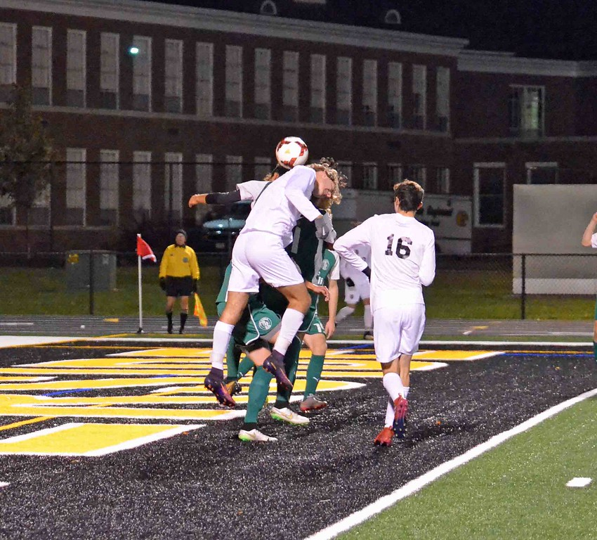 . Paul DiCicco - The News-Herald Players fend for a header Oct. 28.