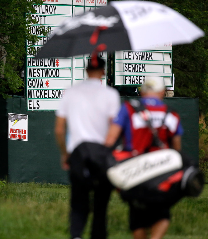 . Estanislao Goya, of Argentina, walks up the 18th hole during a second weather delay during the first round of the U.S. Open golf tournament at Merion Golf Club, Thursday, June 13, 2013, in Ardmore, Pa. (AP Photo/Morry Gash)