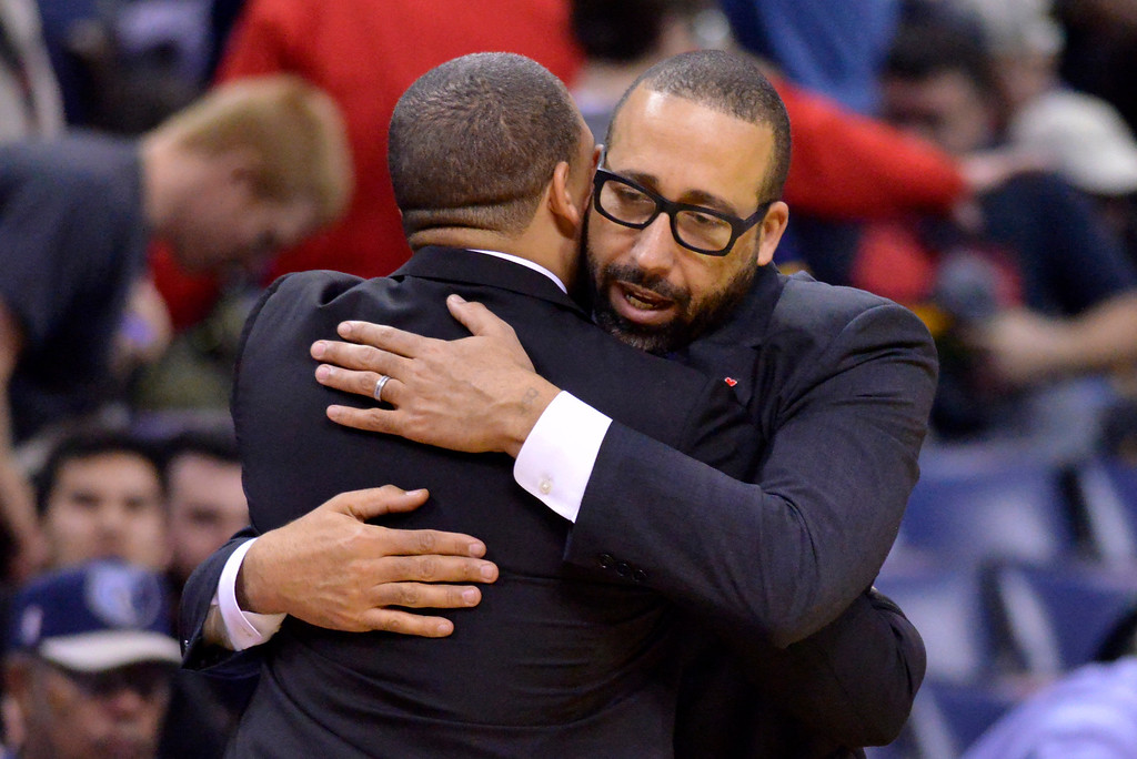. Memphis Grizzlies head coach David Fizdale, right, and Cleveland Cavaliers head coach Tyronn Lue greet each other after an NBA basketball game Wednesday, Dec. 14, 2016, in Memphis, Tenn. (AP Photo/Brandon Dill)