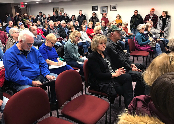 1/9/2020 Mike Orazzi | Staff Residents pack an information meeting held at the Manross Library about a proposed gated high-end multi-family residential project proposed for the Redstone Hill Road area in the city of Bristol.