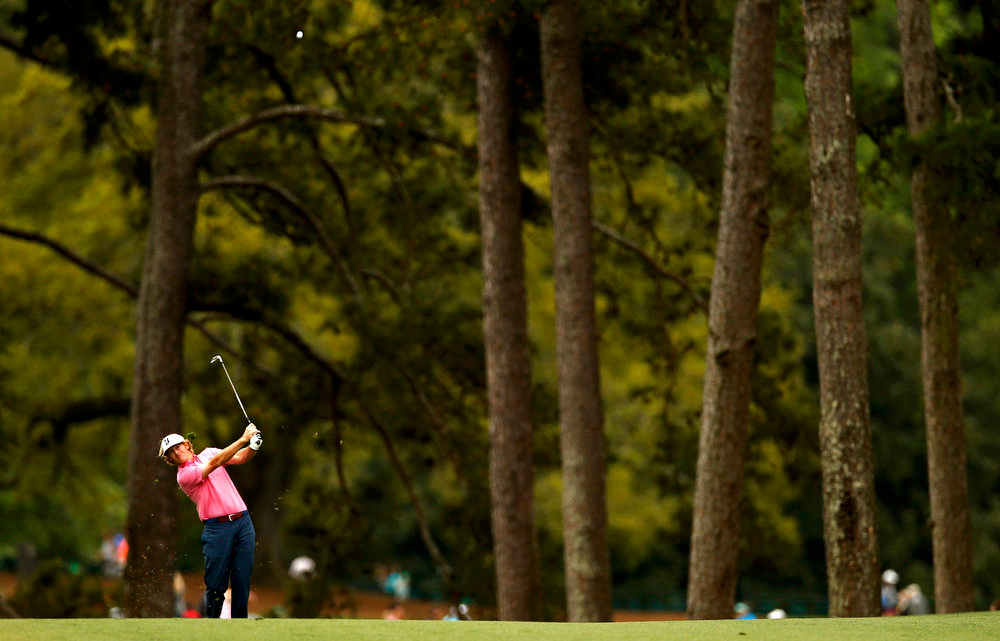 Description of . Brandt Snedeker of the U.S. hits his approach shot to the first green during final round play in the 2013 Masters golf tournament at the Augusta National Golf Club in Augusta, Georgia, April 14, 2013.  REUTERS/Mark Blinch