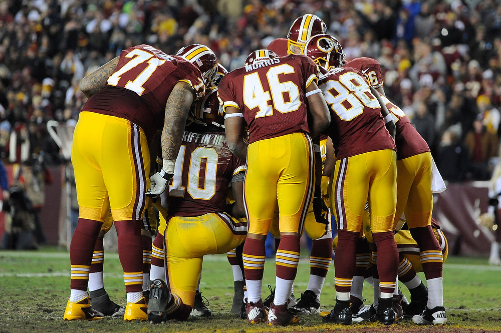. The Washington Redskins huddle around Robert Griffin III #10 during their NFC Wild Card Playoff Game against the Seattle Seahawks at FedExField on January 6, 2013 in Landover, Maryland.  (Photo by Patrick McDermott/Getty Images)