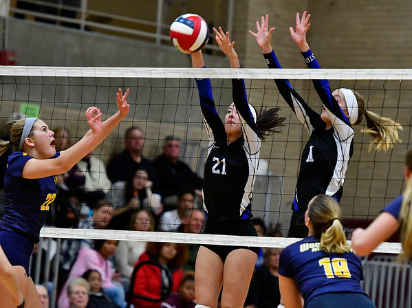 11/14/2018 Mike Orazzi | Staff Bristol Eastern's Aliana Rivoira (21) and Ryley Plourde (11)with Woodstock Academy's Natalie Low (22) during the Class L Semifinal State Girls Volleyball Tournament held at Windsor High School Wednesday night.