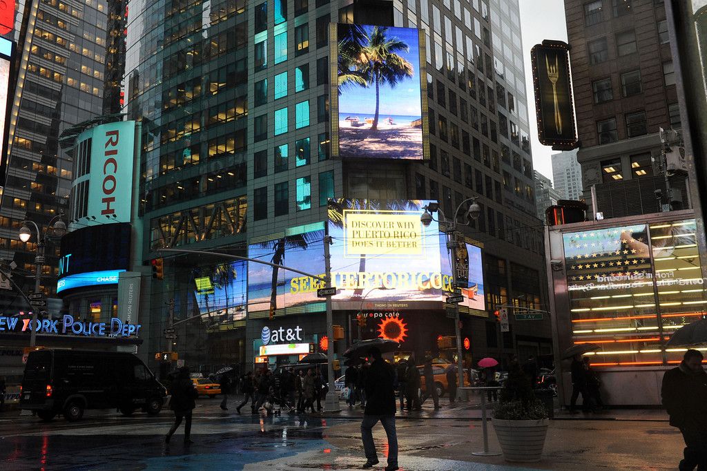 ". In this photograph taken by AP Images for  Puerto Rico Tourism Company, Puerto Rico\'s new ad campaign, ""Puerto Rico Does It Better!,\"" is displayed in New York\'s Times Square, Tuesday, Nov. 30, 2010.  (Diane Bondareff/AP Images for Puerto Rico Tourism Company)"