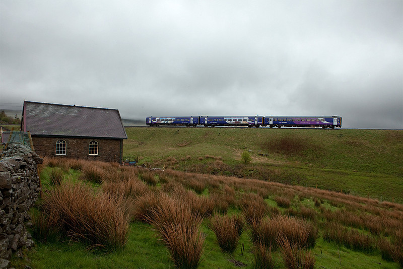 DMU passes the Hawes Junction Methodist Church near Garsdale.
