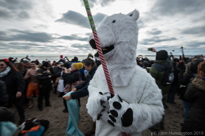 CONEY ISLAND, BROOKLYN, NY/USA -  JANUARY 1, 2016: A costumed participant walks on the beach during the Polar Bear dip.