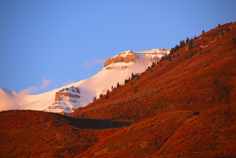 10/7/07 – Shot from my home you can see Baldy in front and snow covered Timpanogos in the background. The setting sun has cast a red glow over everything.