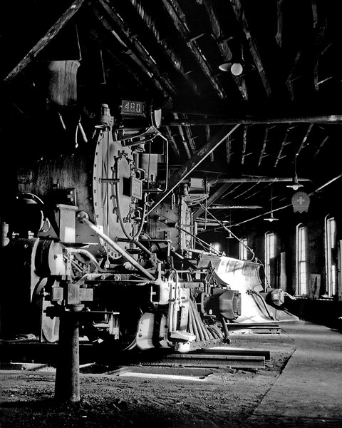 The afternoon sun warms the smoke boxes of two narrow gauge engines.  Alamosa roundhouse.  December 1961.