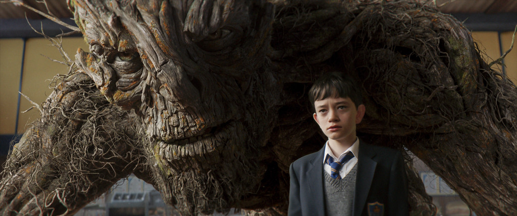 . Conor O�Malley, portrayed by Lewis MacDougall, makes an unlikely friend in a tree monster � Liam Neeson in a motion-capture performance � in �A Monster Calls.� The movie is in theaters Jan. 6. (Focus Features)