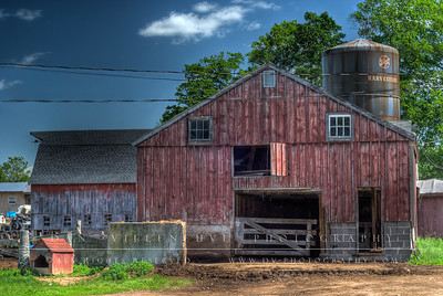 This is a High Dynamic Range (HDR) capture of one of the barns. This particular barn is storage for baled hay as well as extra shelter for the over 300 head of dairy cattle.