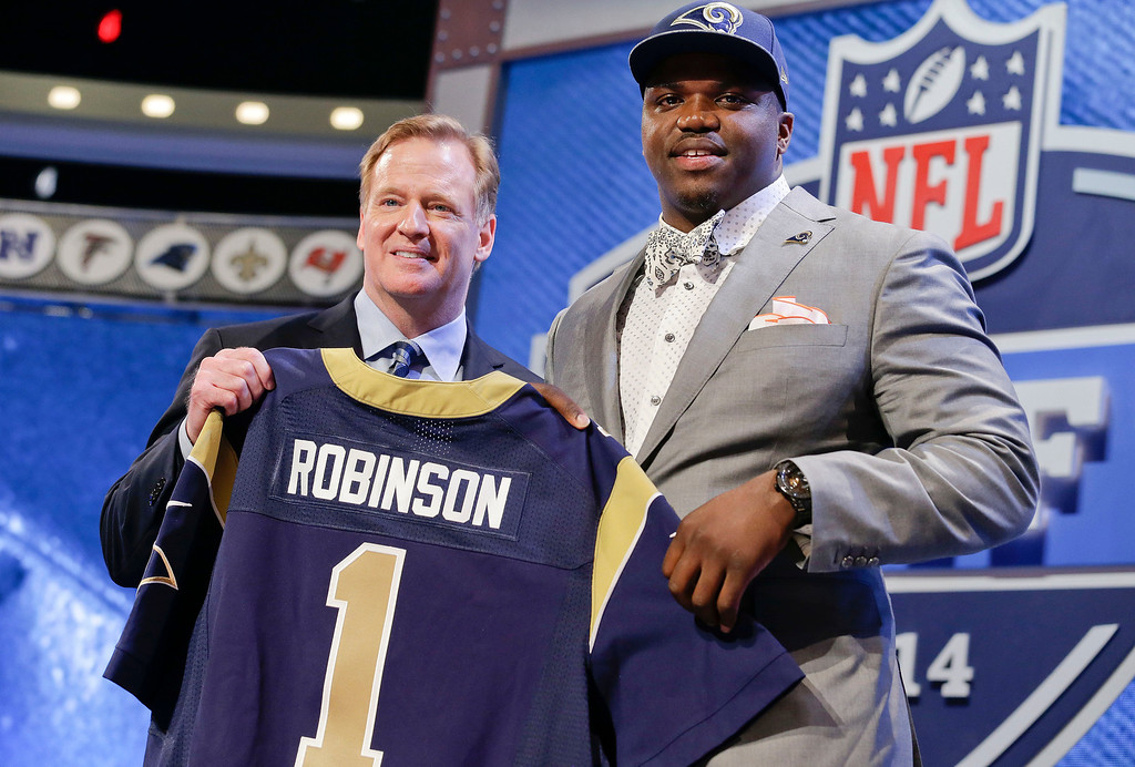. Auburn tackle Greg Robinson, right, poses with NFL commissioner Roger Goodell after being chosen by the St. Louis Rams as the second pick in the first round of the 2014 NFL Draft, Thursday, May 8, 2014, in New York. (AP Photo/Craig Ruttle)