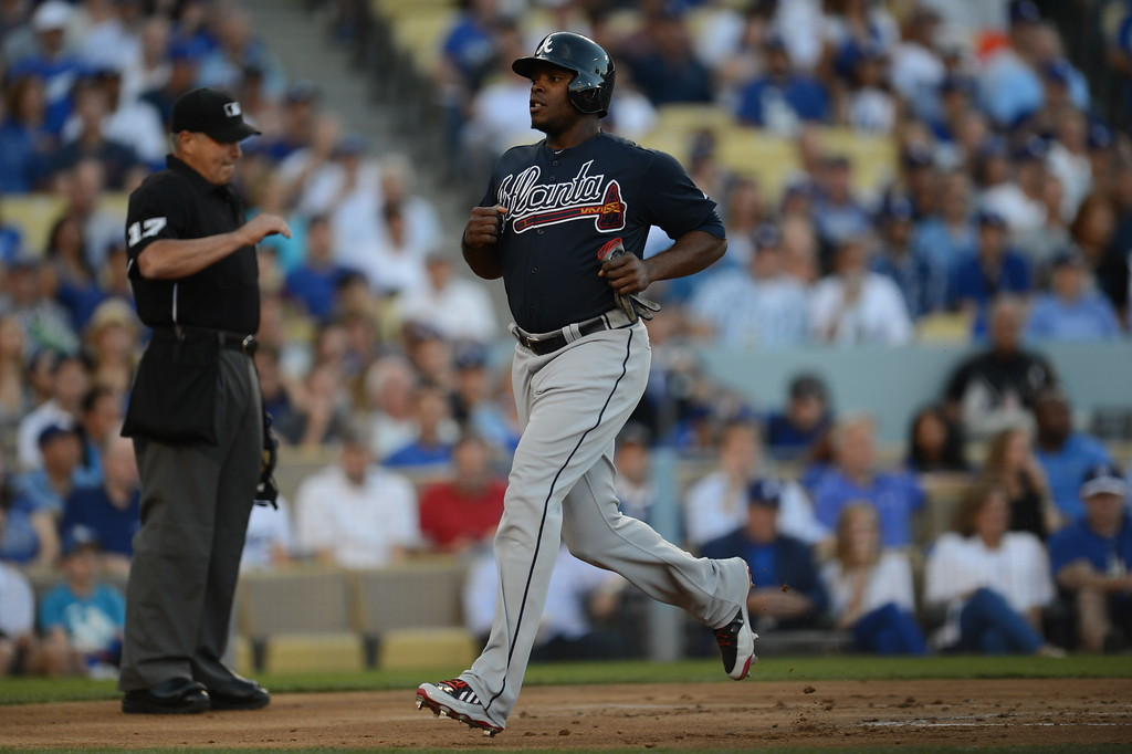 . The Brave\'s Justin Upton scored on  Evan Gattis single to center during game 3 of the NLDS at Dodger Stadium Sunday, October 6, 2013. (Photo by Hans Gutknecht/Los Angeles Daily News)