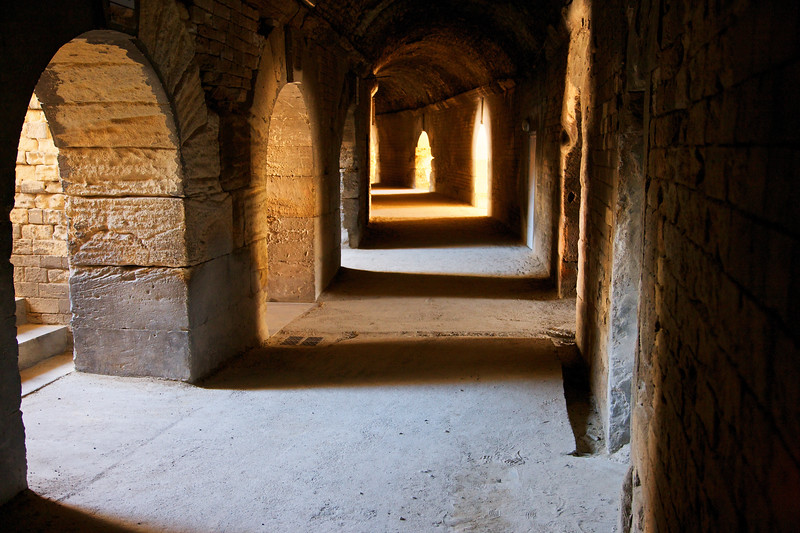 Arches, Light and Shadow inside the Arles Arena, France