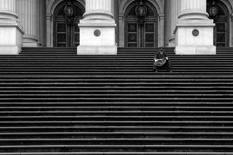 Melbourne | Australia Reading the newspaper at the stairs