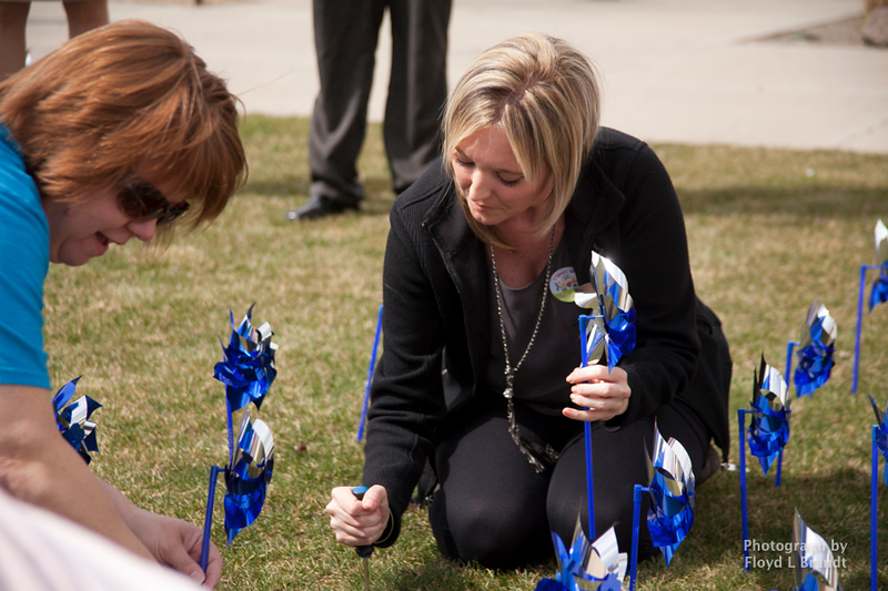 Havre Daily News/Floyd BrandtCASA member Katie Lyons met in Town Square to plant pinwheels Thursday. Each pinwheel represents a child that CASA has intervended for. There are 211 pinwheels planted in the square. Executive Director Mark Douglas said that he was glad that the number not any higher.