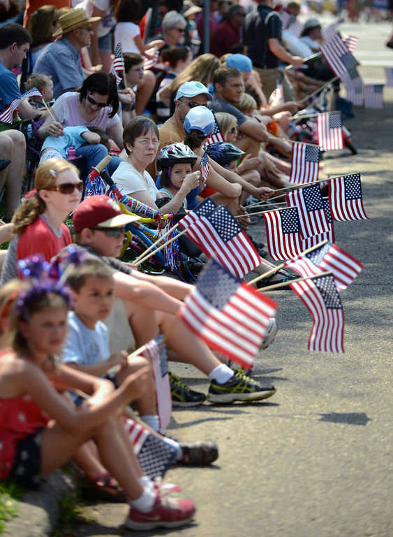 . There was no shortage of flags among spectators waiting along Como Avenue for the St. Anthony Park Independence Day parade.  (Pioneer Press: Chris Polydoroff)