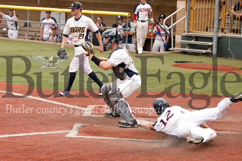 Shaler's Collin Harger  reaches past Mars' catcher Teddy Ruffner to score. Seb Foltz/Butler Eagle