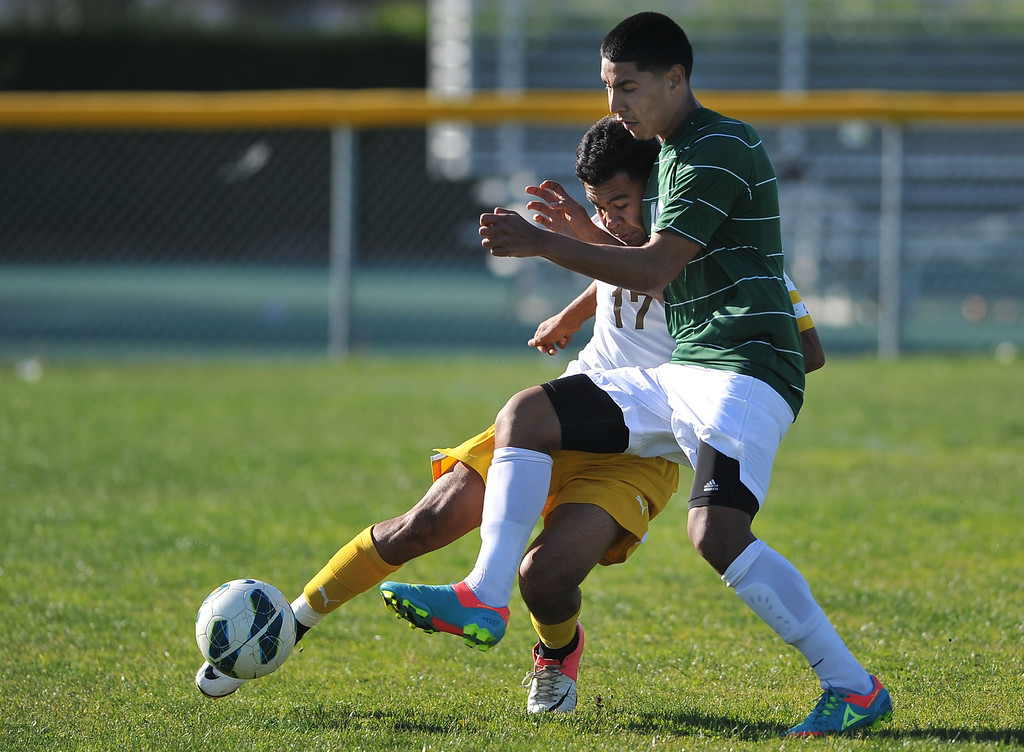 . 2/13/13 - L-R Daniel Ruiz of Kennedy High School battles for the ball against  Angel Hernandez of Narbonne during the L.A. City Section Division I playoffs. Narbonne won 1-0. Photo by Brittany Murray / Staff Photographer