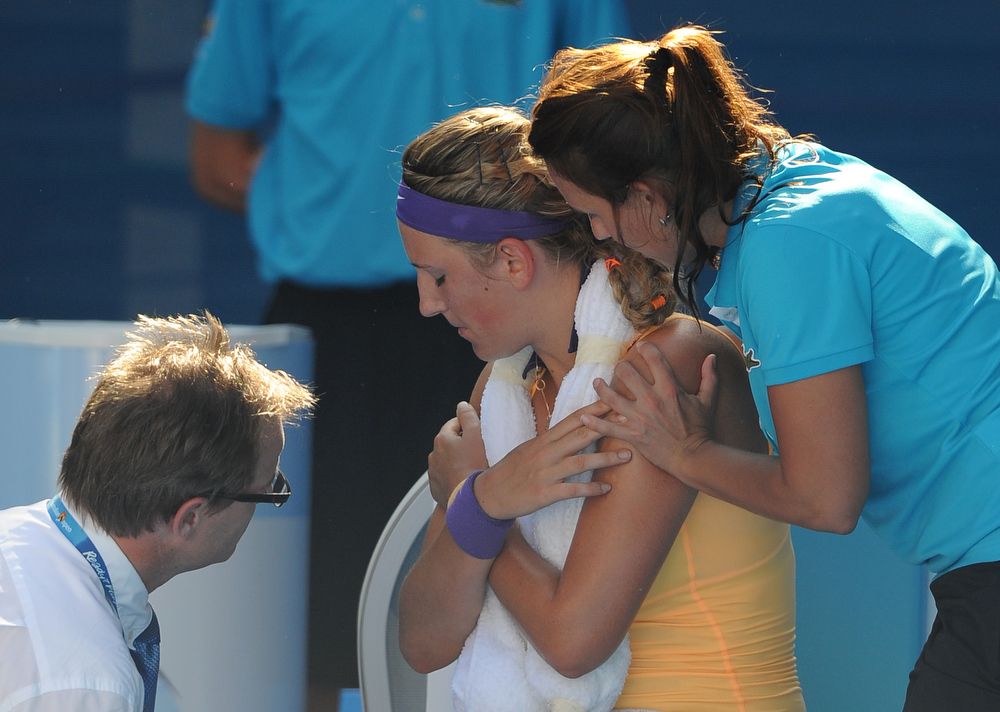 Description of . Victoria Azarenka of Belarus receives treatment from a trainer during her semifinal match against Sloane Stephens of the US at the Australian Open tennis championship in Melbourne, Australia, Thursday, Jan. 24, 2013. (AP Photo/Andrew Brownbill)