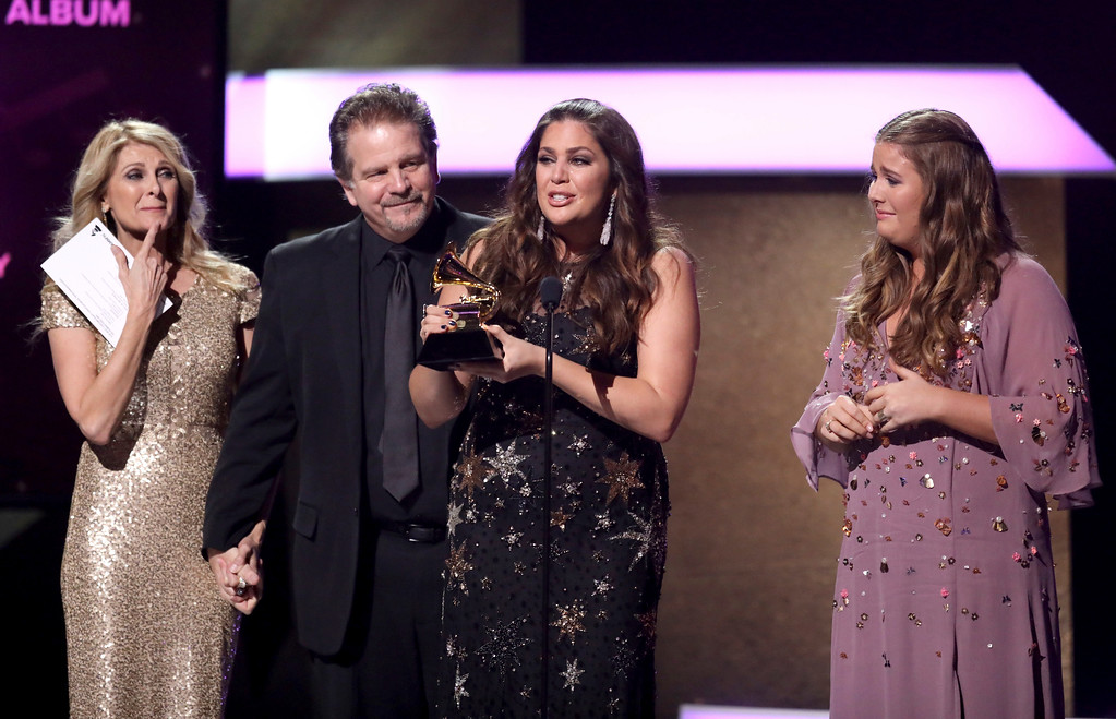 ". Linda Davis, from left, Lang Scott, Hillary Scott, and Rylee Scott accept the award for best contemporary christian music album for ""Love Remains\"" at the 59th annual Grammy Awards on Sunday, Feb. 12, 2017, in Los Angeles. (Photo by Matt Sayles/Invision/AP)"