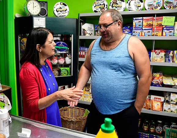 8/4/2018 Mike Orazzi | Staff Connecticut 5th Congressional District democratic candidate Mary Glassman talks with Andrzej Czubat at the Green Grocer in New Britain Saturday.