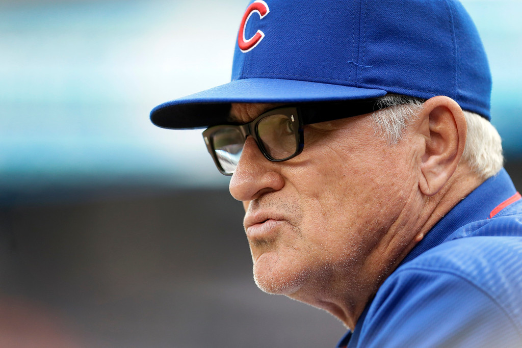 . Chicago Cubs manager Joe Maddon looks out from the dugout during the first inning of the Cubs\' baseball game against the Detroit Tigers, Tuesday, June 9, 2015, in Detroit. (AP Photo/Carlos Osorio)