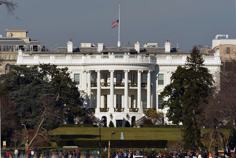 . The US flag flies at half-staff above the White House on December 15, 2012 in Washington. Twenty-seven people, including the shooter, were killed on December 14 at Sandy Hook Elementary School in Newtown, Connecticut.     MANDEL NGAN/AFP/Getty Images