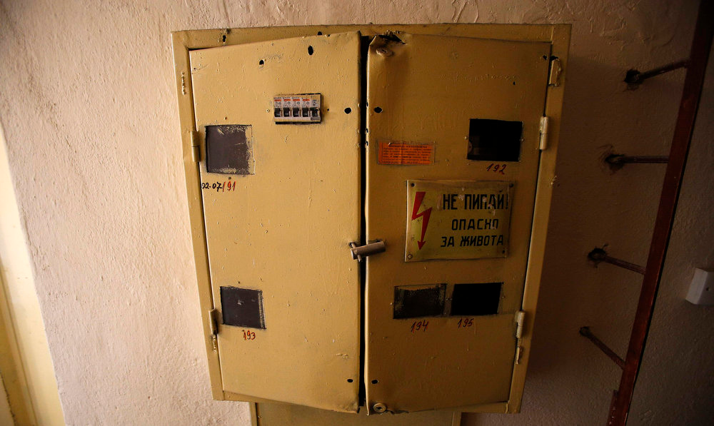 Description of . An electricity meter box is seen outside the apartment of Sirma Antonova in the town of Blagoevgrad, west of Sofia February 22, 2013. Bulgaria's government has bowed to popular anger over high electricity prices and poor governance, but the spirit of protest in struggling towns like Blagoevgrad has not been quenched. Antonova's pension and benefits covered barely half of her December electricity bill of 270 levs ($180). A widow who lives in a two-room apartment with her two children, she has been unemployed since 2008.      REUTERS/Stoyan Nenov