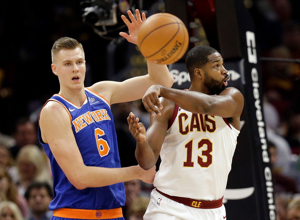 . Cleveland Cavaliers\' Tristan Thompson (13) passes against New York Knicks\' Kristaps Porzingis (6), from Latvia, in the second half of an NBA basketball game, Sunday, Oct. 29, 2017, in Cleveland. (AP Photo/Tony Dejak)