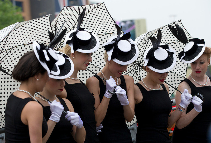 . A vocal group line up as they pose for the media on the third day traditionally known as Ladies Day of the Royal Ascot horse race meeting in Ascot, England, Thursday, June 20, 2013. (AP Photo/Alastair Grant)