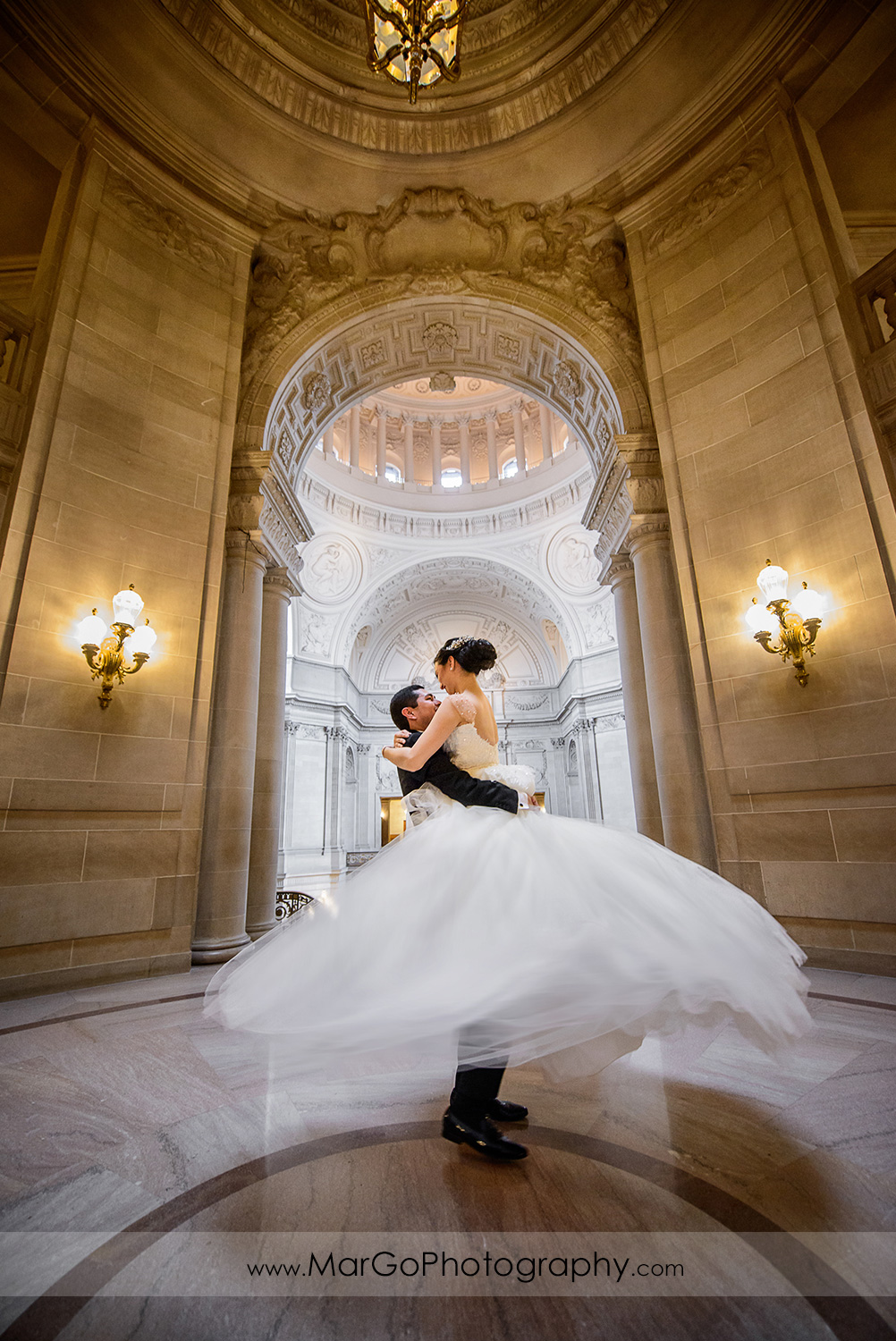 bride and groom dancing in the Rotunda in San Francisco City Hall
