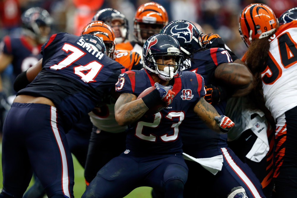. Arian Foster #23 of the Houston Texans runs the ball in the first half against the Cincinnati Bengals during their AFC Wild Card Playoff Game at Reliant Stadium on January 5, 2013 in Houston, Texas.  (Photo by Scott Halleran/Getty Images)