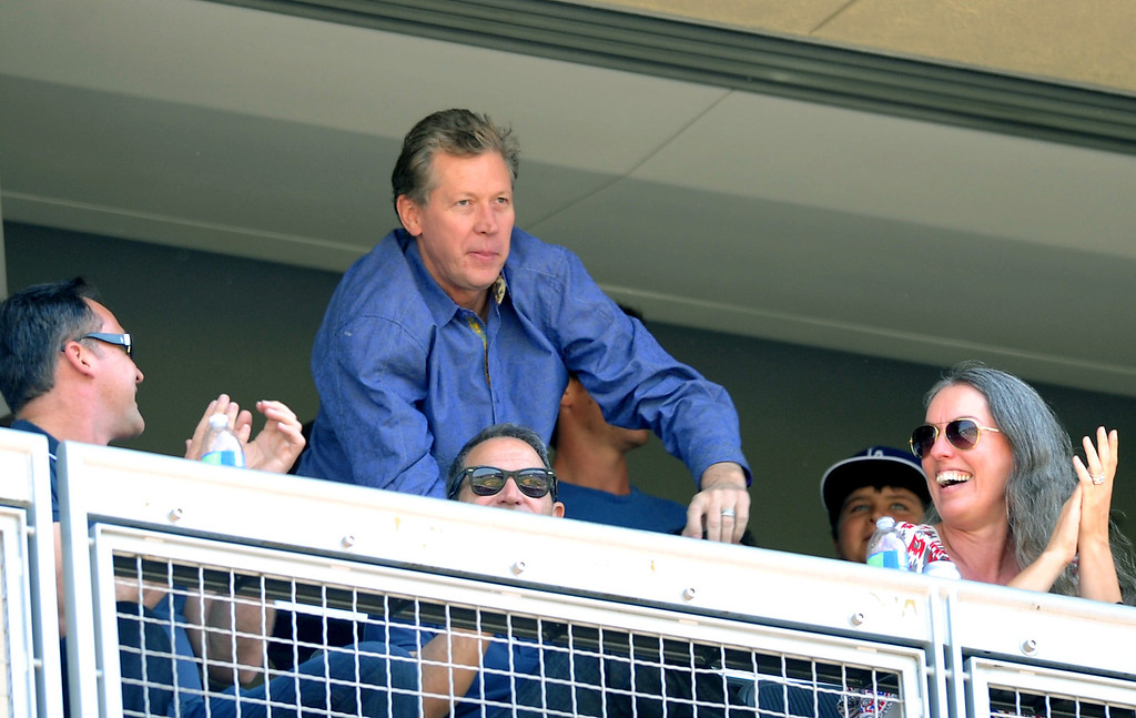 . Orel Hershiser waves to the crowd between inning Saturday, August 10, 2013, at Dodger Stadium. (Michael Owen Baker/L.A. Daily News)