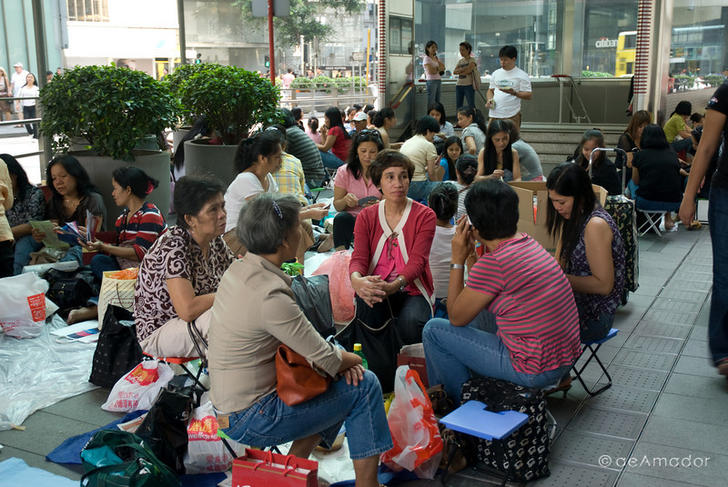 aeamador©-HK08_DSC0111  Hong Kong, downtown area, near ifc tower. I was very impressed by the affluence evidenced in this area. Hong Kong is quite a chic and fine place. These are Filipino maids that fill the entire downtown public spaces (sidewalks, streets and plazas) for picnicking. There are thousands of them, spread all over. No husbands, no men, no children. Just the women. Sunday is their day off.