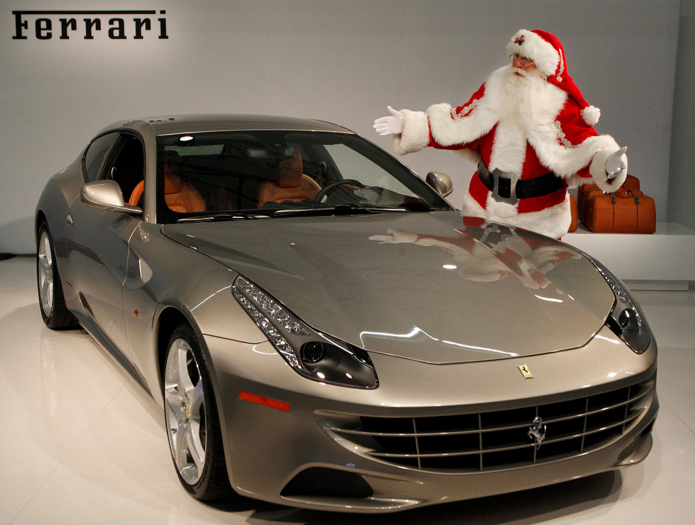 Description of . The 2012 Ferrari FF is presented by Brady White portraying Santa Claus during the unveiling of the Neiman Marcus Christmas catalog in Dallas, Tuesday, Oct. 18, 2011. The sports car priced at $395,000 jumps from 0 to 60 in less than 3.7 seconds and reaches top speeds of over 200 MPH but delivery is not promised until Spring of 2012. (AP Photo/LM Otero)