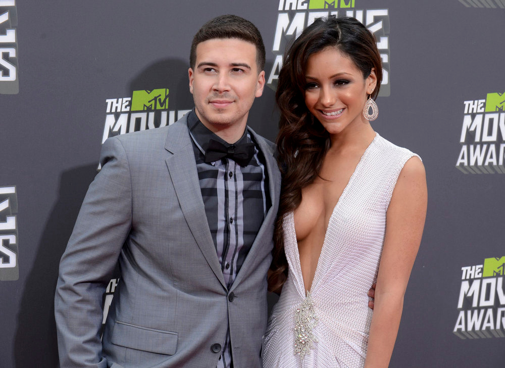. Vinny Guadagnino and girlfriend Melanie Iglesias arrive at the 2013 MTV Movie Awards in Culver City, California April 14, 2013.   REUTERS/Phil McCarten