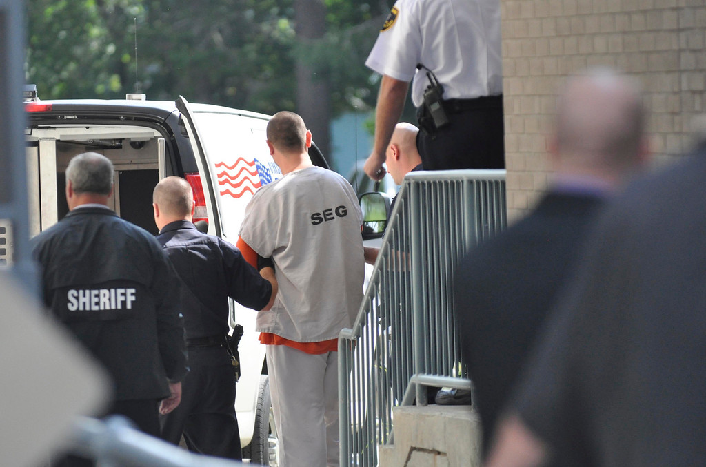 . Adam Lee Hall is led out of Berkshire District Court under very tight security, Mojn Sept 12, 2011.  (GARVER)