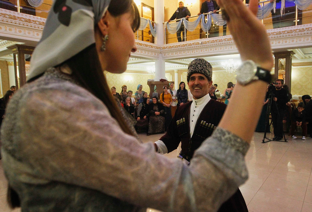 . Guests dance at a wedding in the Chechen capital Grozny April 24, 2013. The naming of two Chechens, Dzhokhar and Tamerlan Tsarnaev, as suspects in the Boston Marathon bombings has put Chechnya - the former site of a bloody separatist insurgency - back on the world\'s front pages. Moscow has poured billions of roubles into rebuilding Chechnya, a mainly Muslim province that has seen centuries of war and repression. Picture taken April 24, 2013.   REUTERS/Maxim Shemetov