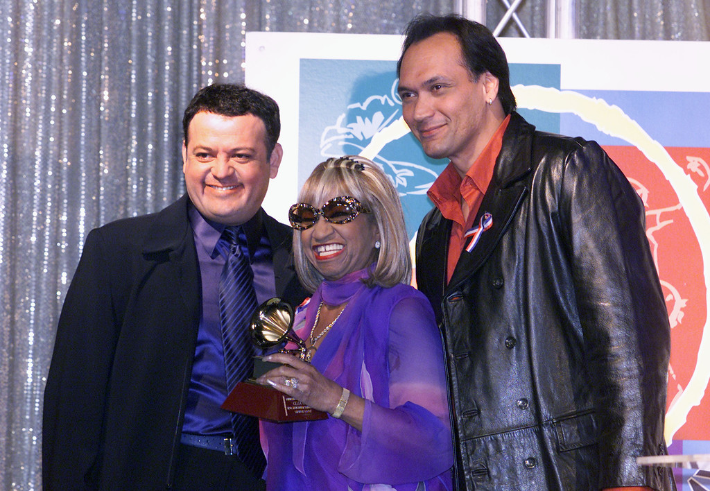 ". Hosts Paul Rodriguez and Jimmy Smits pose with winner for Best Traditional Tropical Album ""Siempre Vivire\"", Celia Cruz at the press conference to announce the winners for the 2nd Annual Latin Grammy Awards held at the Conga Room in Los Angeles, CA., Oct 30, 2001.  (Photo by Kevin Winter/Getty Images)"