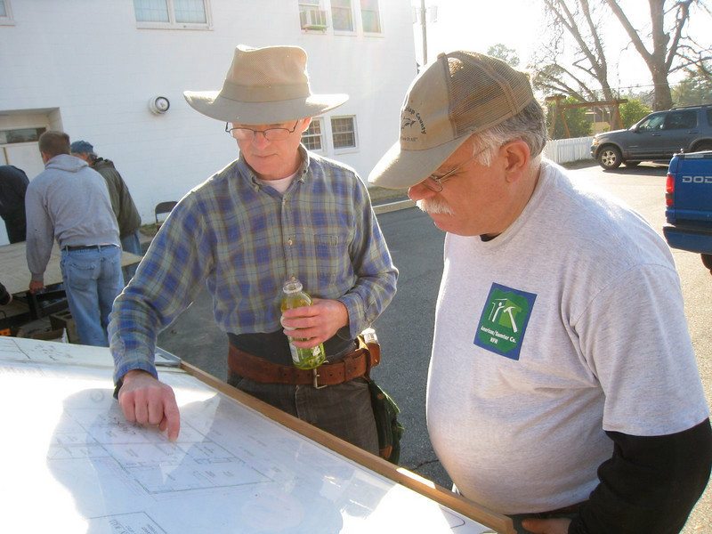 10 1-17 MLK Day - Wayne Nelson (left) and Tom McFarland check house plans. ky